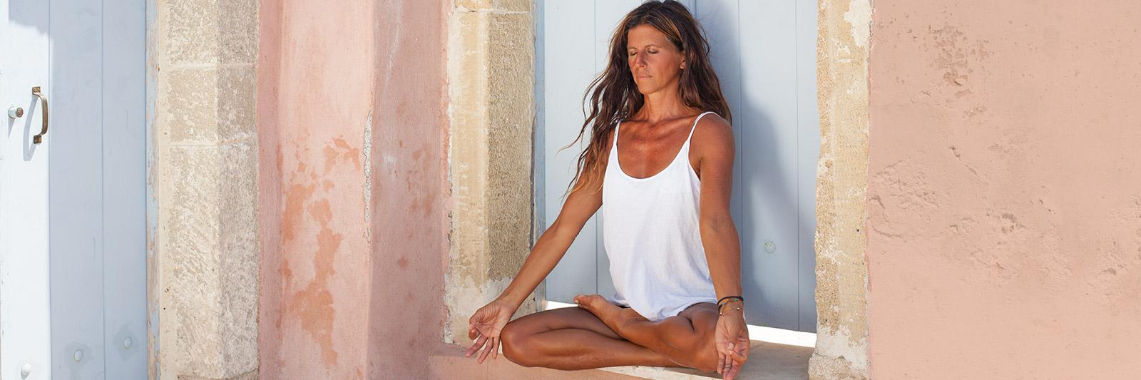 Gloria Latham meditating in a greek style house